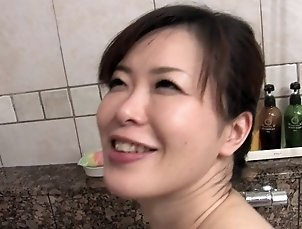 Japanese bitch strokes and sucks guy's hard tool