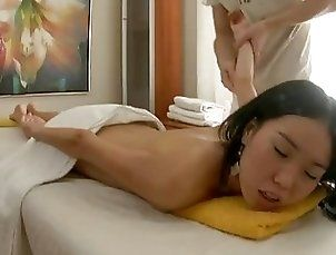 Asian girl enjoys a massage before getting fucked